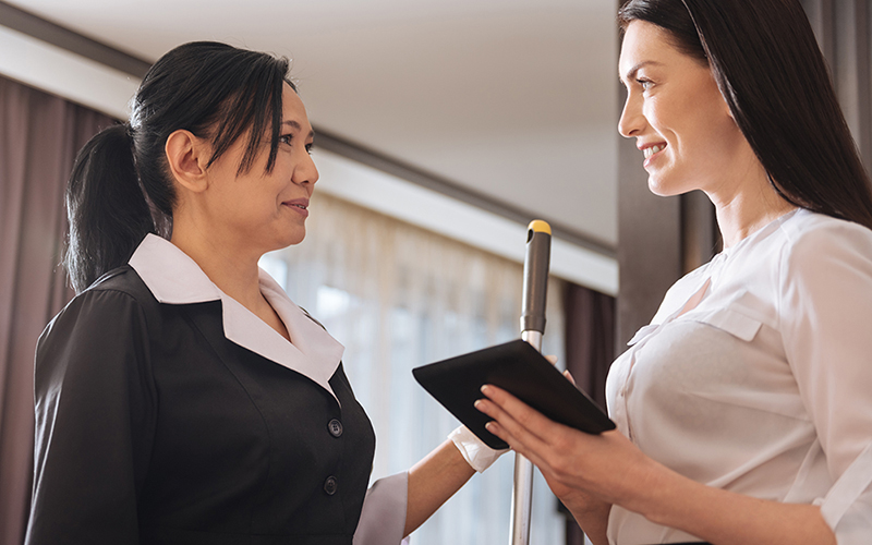 Smiling female housekeeper and manager having a pleasant conversation. | MasterCorp