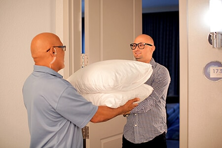 http://Portfolio%20-%20Our%20Partners%20-%20Man%20delivering%20pillows%20to%20someone%20in%20their%20hotel%20room%20|%20MasterCorp