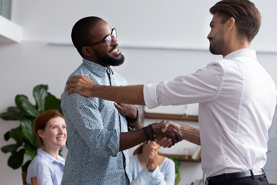 MasterCorp Values: Respect - Company boss congratulating handshaking with successful employee.